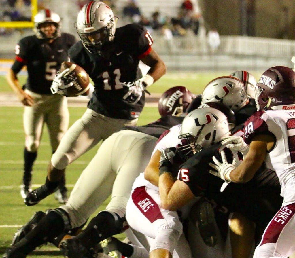 Union running back Shamari Brooks punches in a 1-yard touchdown run to help give the Redskins a 45-21 victory over rival Jenks on Friday night in Owasso. (PHOTO: John E. Hoover)