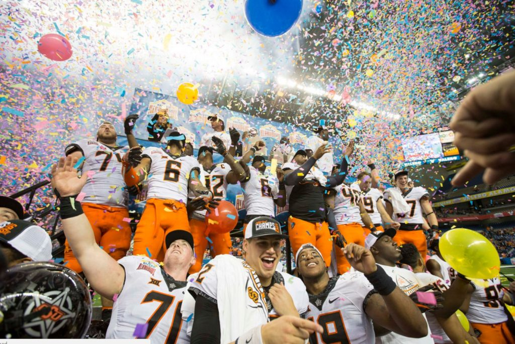 Mason Rudolph and the Oklahoma State Cowboys celebrate their 38-8 victory over Colorado on Thursday at the Alamodome in San Antonio. (PHOTO: Bruce Waterfield/OSU media relations)