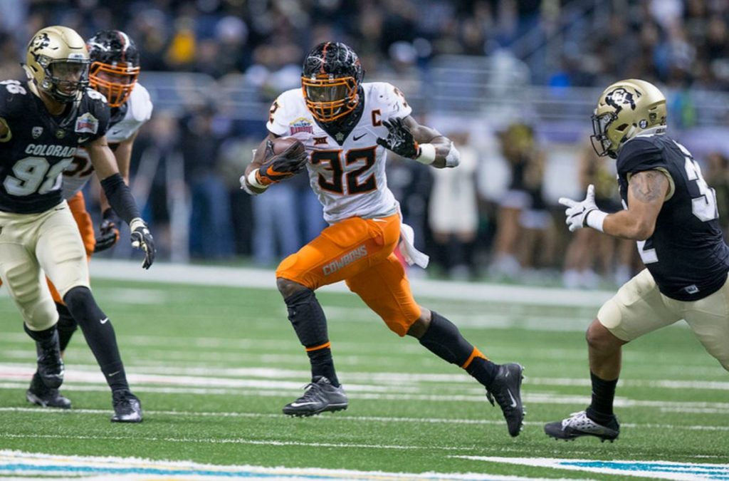 Chris Carson rushed for 61 yards on 11 carries Thursday in the Alamo Bowl against Colorado. (PHOTO: Bruce Waterfield/OSU media relations)
