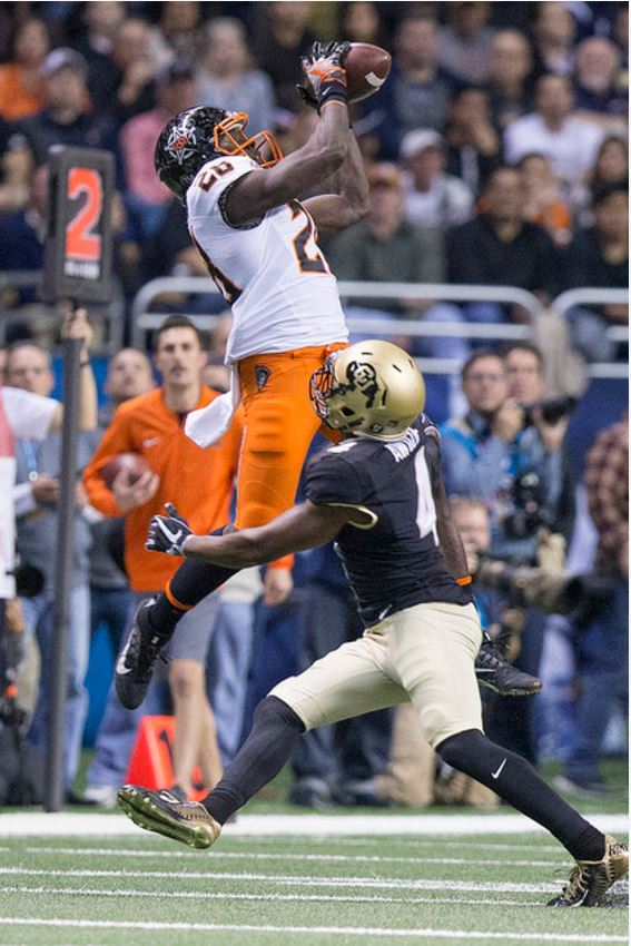 James Washington elevates for another reception over Colorado cornerback Chidobe Awuzie in the Alamo Bowl on Thursday night. (PHOTO: Bruce Waterfield/OSU media relations)