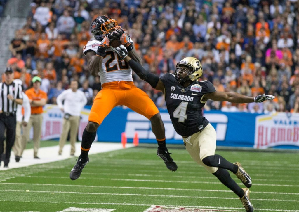 OSU's James Washington catches another pass over Colorado's Chidobe Awuzie on Thursday in the Alamo Bowl. (PHOTO: Bruce Waterfield/OSU media relations)
