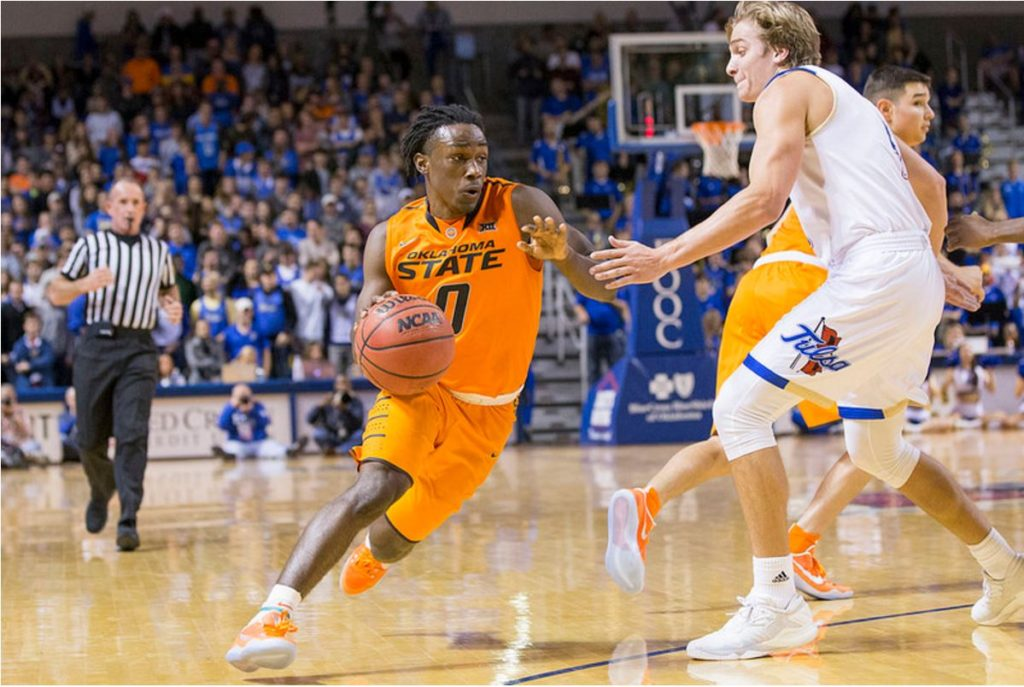Oklahoma State point guard Brandon Averette dribbles around Tulsa's Lawson Korita on Saturday at the University of Tulsa's Reynolds Center. Averette scored 17 points to help OSU beat TU 71-67. (PHOTO: Bruce Waterfield/OSU Athletics)