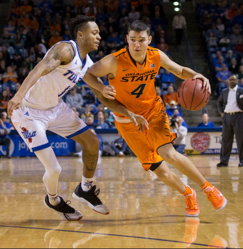 Oklahoma State's Thomas Dziagwa drives around Tulsa' Pat Birt during their game on Saturday night at TU's Reynolds Center. Dziagwa hit three 3-pointers and scored 11 points in the second half of the Cowboys' 71-67 victory over the Golden Hurricane. (PHOTO: Bruce Waterfield/OSU Athletics)