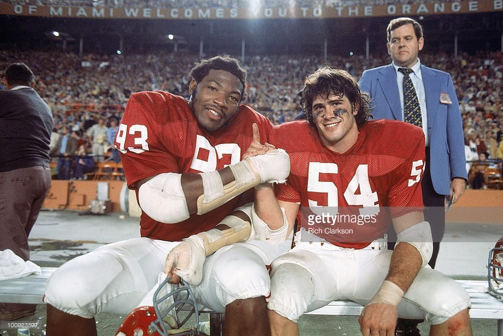 Jimbo Elrod (right) poses with the late Lee Roy Selmon during OU's 14-6 win over Michigan in the 1976-76 Orange Bowl. Elrod died early Monday in a one-car crash during an overnight drive from Oklahoma City to Tulsa.