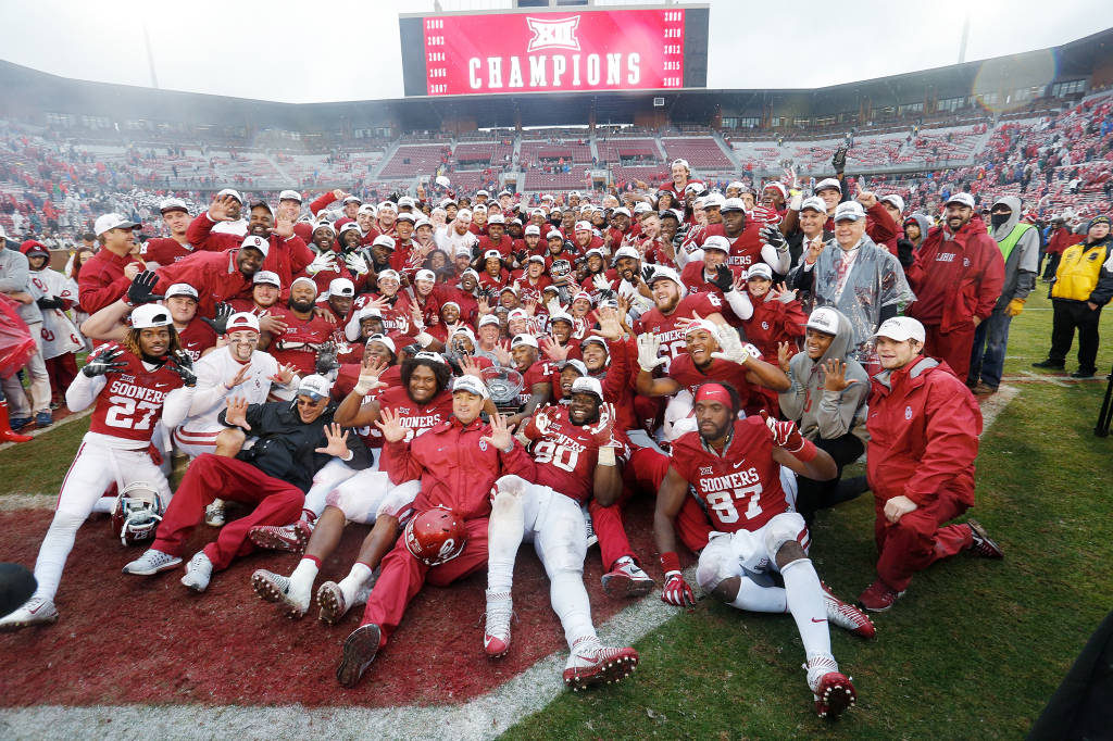 The Oklahoma football team celebrates its 10th Big 12 Conference championship, this one on Owen Field. (PHOTO: Ty Russell/OU media relations)
