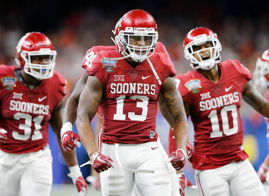 Oklahoma's defense, led here by Ahmad Thomas, dominated the Auburn Tigers all night in a 35-19 Sugar Bowl rout. (PHOTO: Ty Russell/OU media relations)