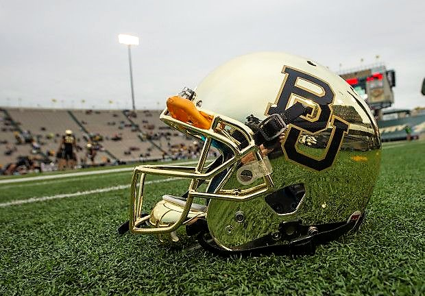 Oct 5, 2013; Waco, TX, USA; A view of the new chrome helmets of the Baylor Bears before the game against the West Virginia Mountaineers at Floyd Casey Stadium. Mandatory Credit: Jerome Miron-USA TODAY Sports