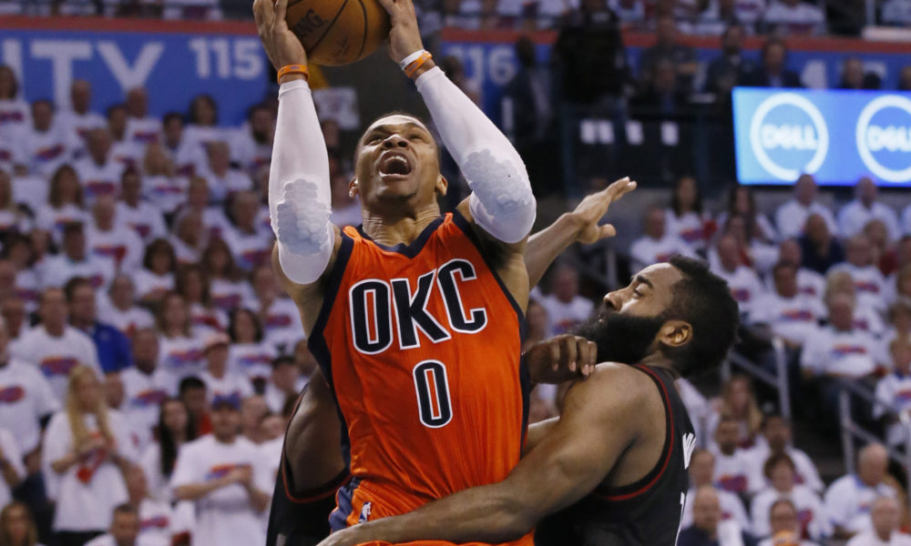 a0c23132a183 Oklahoma City Thunder guard Russell Westbrook (0) shoots between Houston  Rockets guards Patrick Beverley