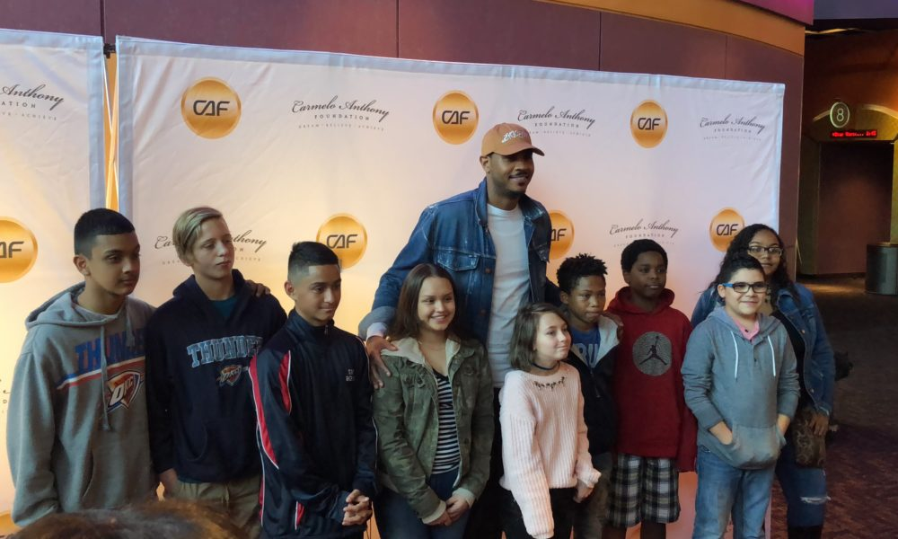 low priced 1e37f 7ee31 WATCH  It s a very Melo Christmas as Carmelo Anthony brings Christmas cheer  to Harkins Theatres