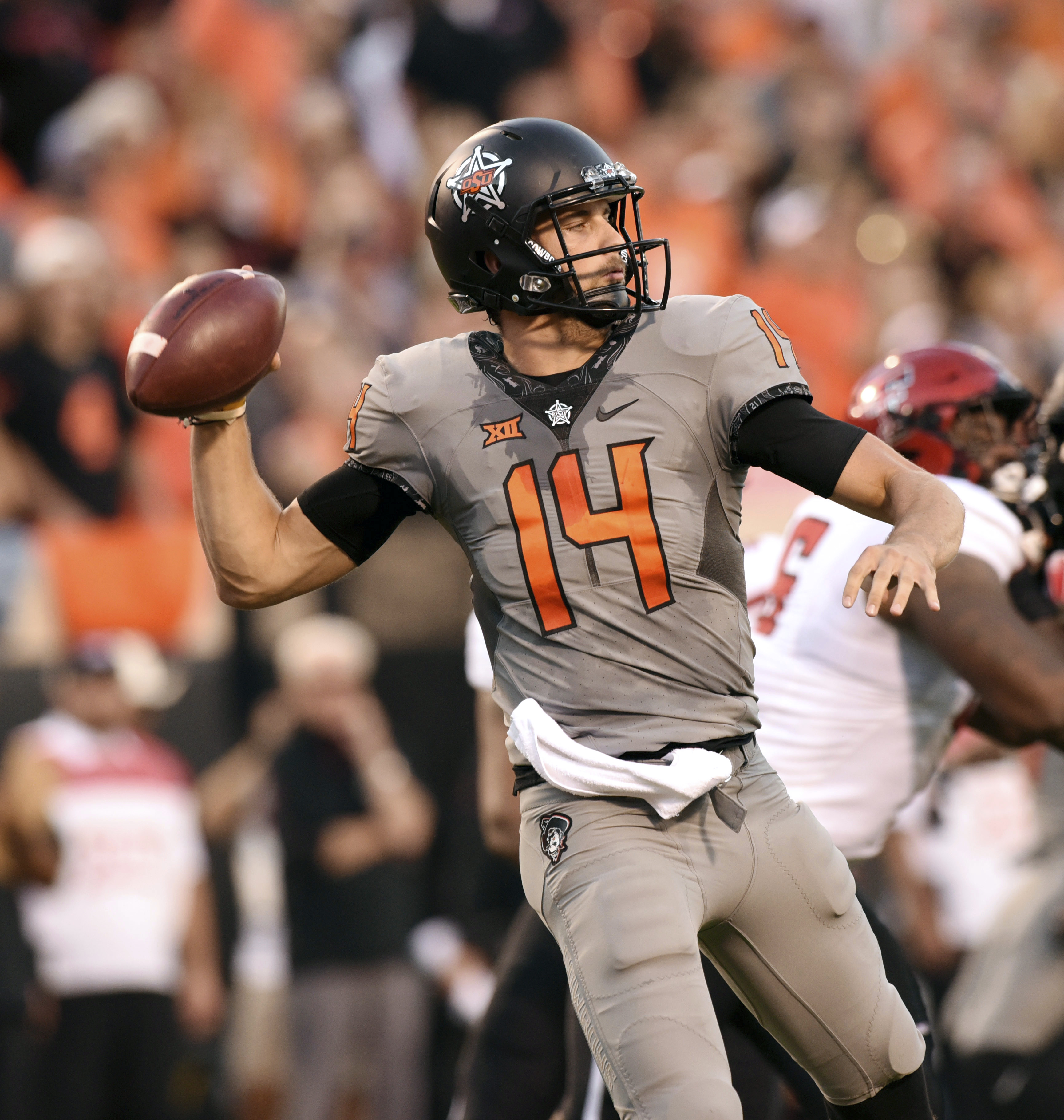 03328a9aa88 Oklahoma State quarterback Taylor Cornelius throws a pass during the first  half of an NCAA college football game against Texas Tech in Stillwater